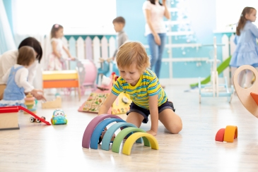 Kids Playing On Floor With Educational Toys. Toys For Preschool